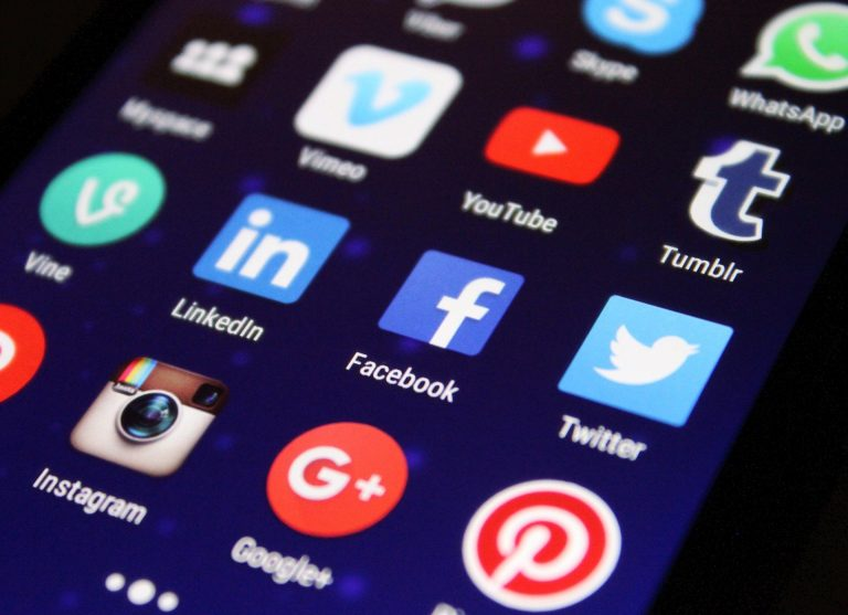 Social media icons on the phone screen